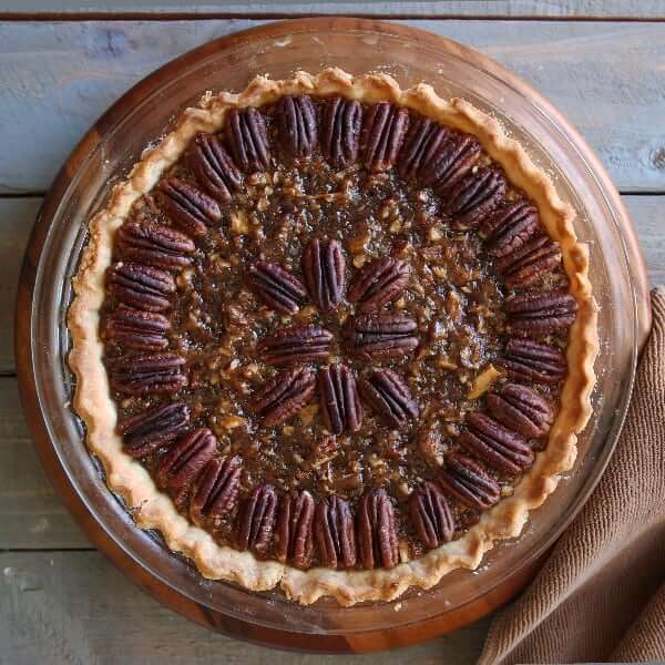 Overhead view of a healthy vegan pecan pie recipe in a glass plate.