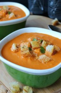Close-up photo of creamy vegan tomato soup.