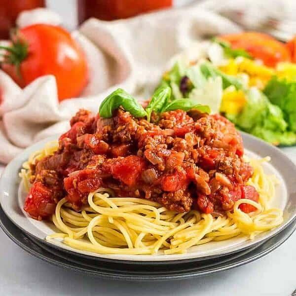 Square photo of the perfect plateful of spaghetti.