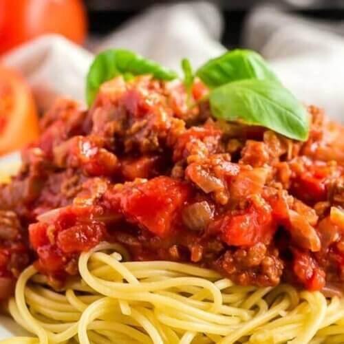 Up close photo of plant based pasta sauce on spaghetti.