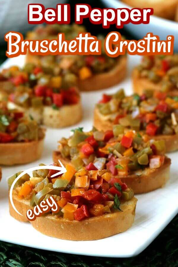 Angled and close-up view of little toasts loaded with easy bruschetta crostini and text at the top for pinning.