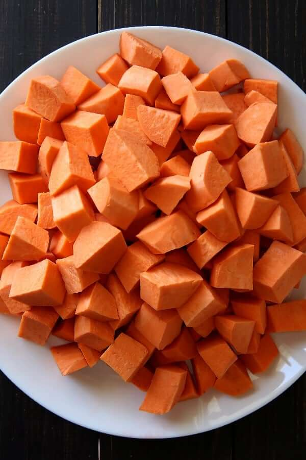 Overhead photo of fresh diced sweet potatoes.