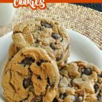 Angled view of five giant cookies on a white plate with descriptive text at the top of the photo.