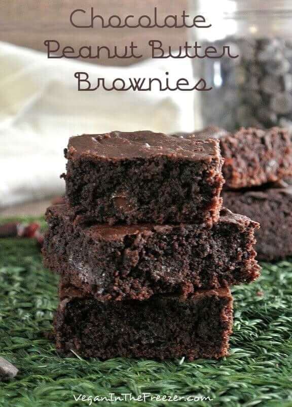 Three stack of chocolate brownies with glistening chocolate chips inside,