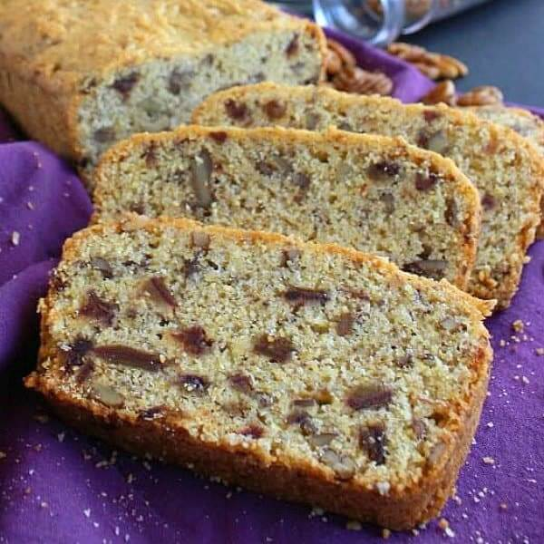 Overlapping slices of cornbread filled with dates and pecans.