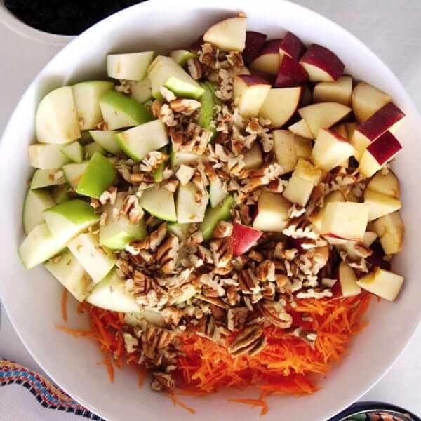 An overhead photo of a bowl with all the raw chopped fruit and vegetables inside.