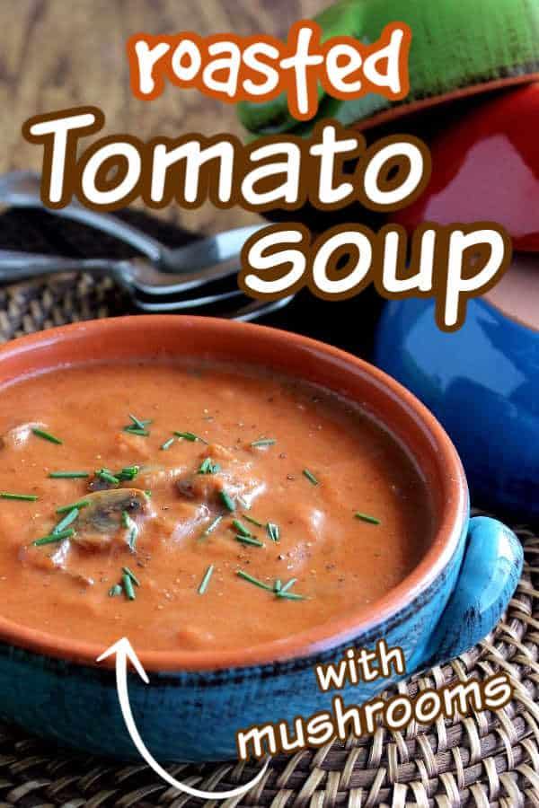 Cropped blue handled bowl filled with thick creamy tomato soup with text overlay for pinterest.
