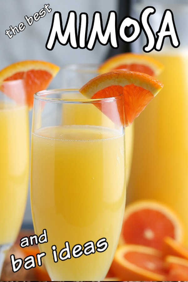 Close-up of mimosas with orange slices as garnish and text for pinning.