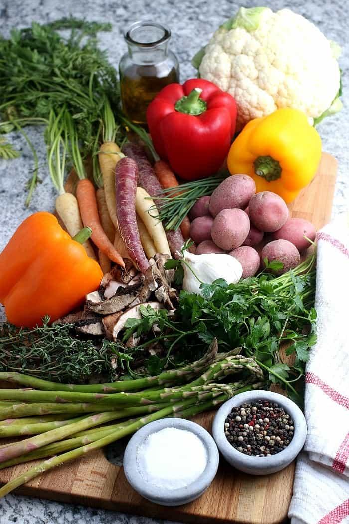 Overhead view of all of the fresh vegetable ingredients and seasonings.