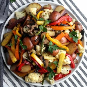 Overhead photo of a colorful plateful of at least 8 vegetables roasted to perfection.