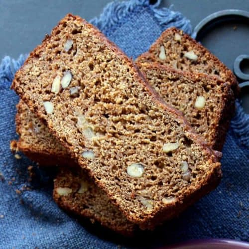 Three slice of pear bread are stacked on top of each other at angles and the photo is taken from above.