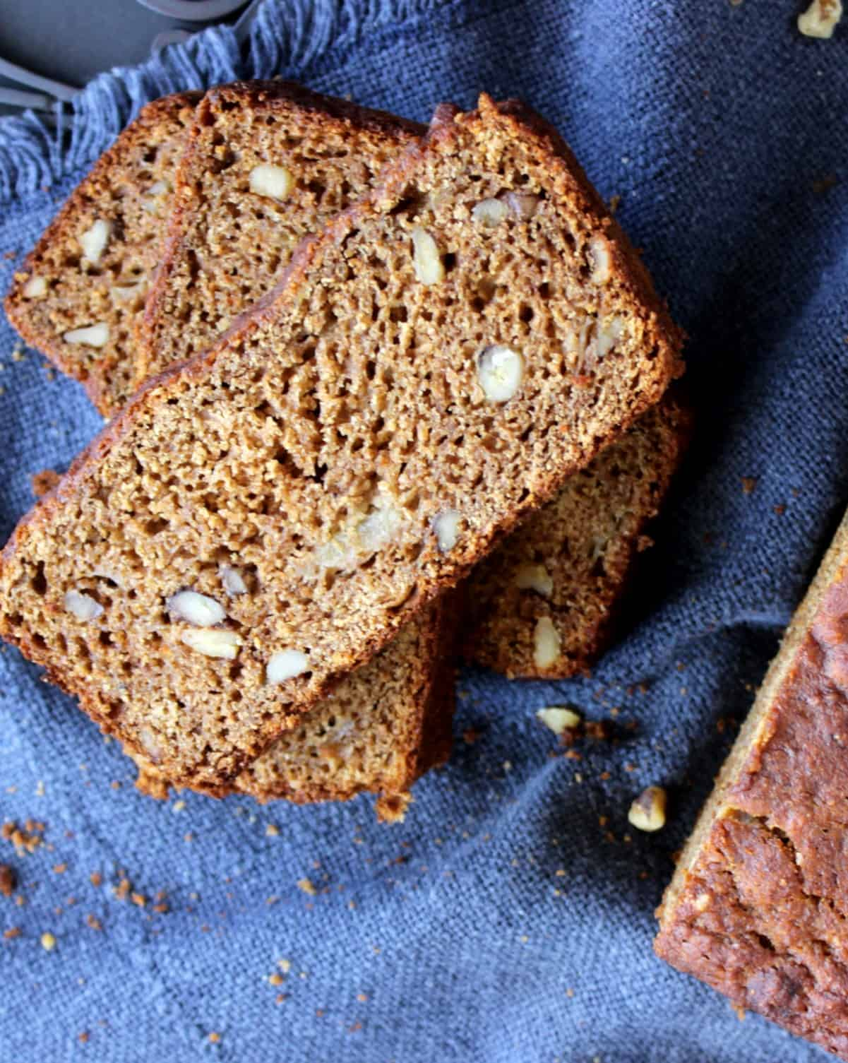 Overhead view of a close-u of slices a rich brown pear bread.