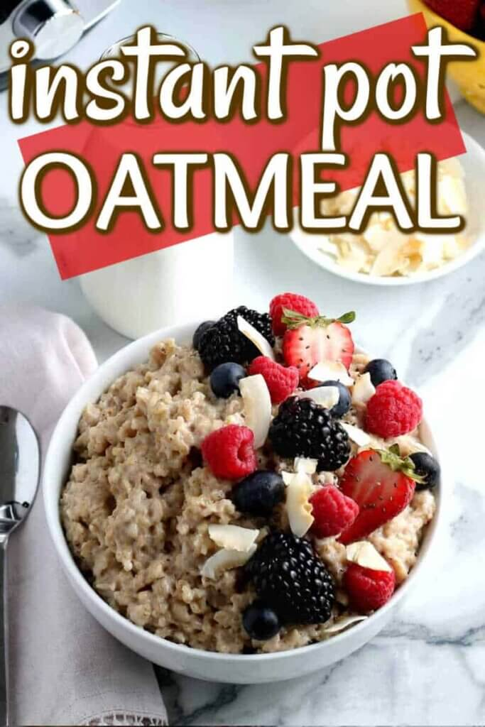 Tilted white bowl of oatmeal scattered with colorful berries with text above for Pinterest.