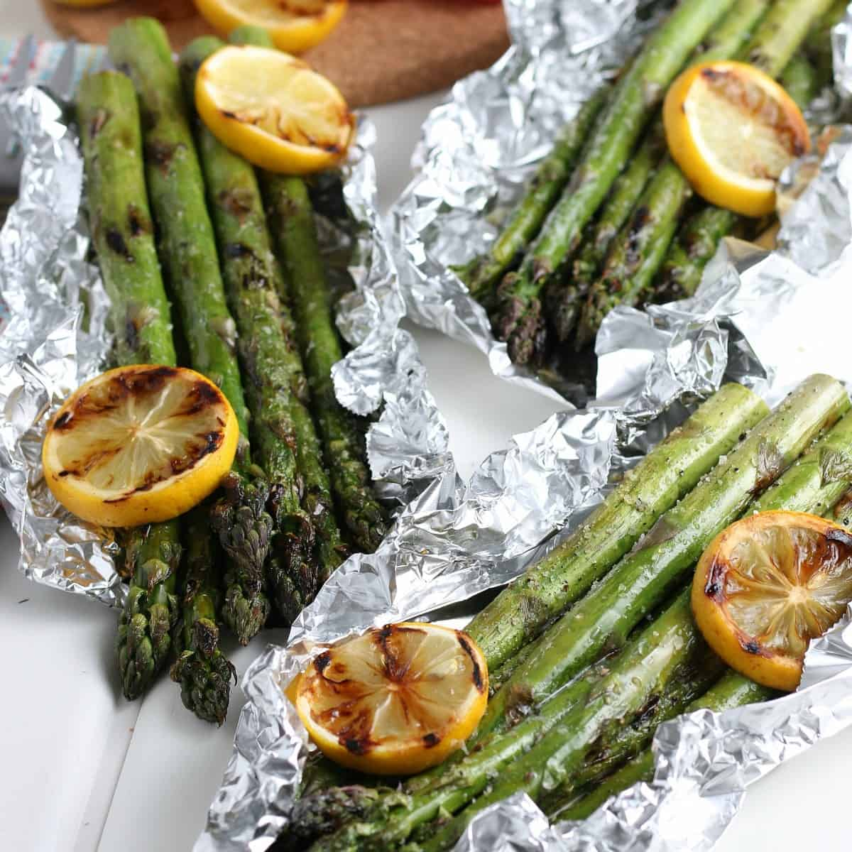 Three packets of veggies after bring grilled and opened.