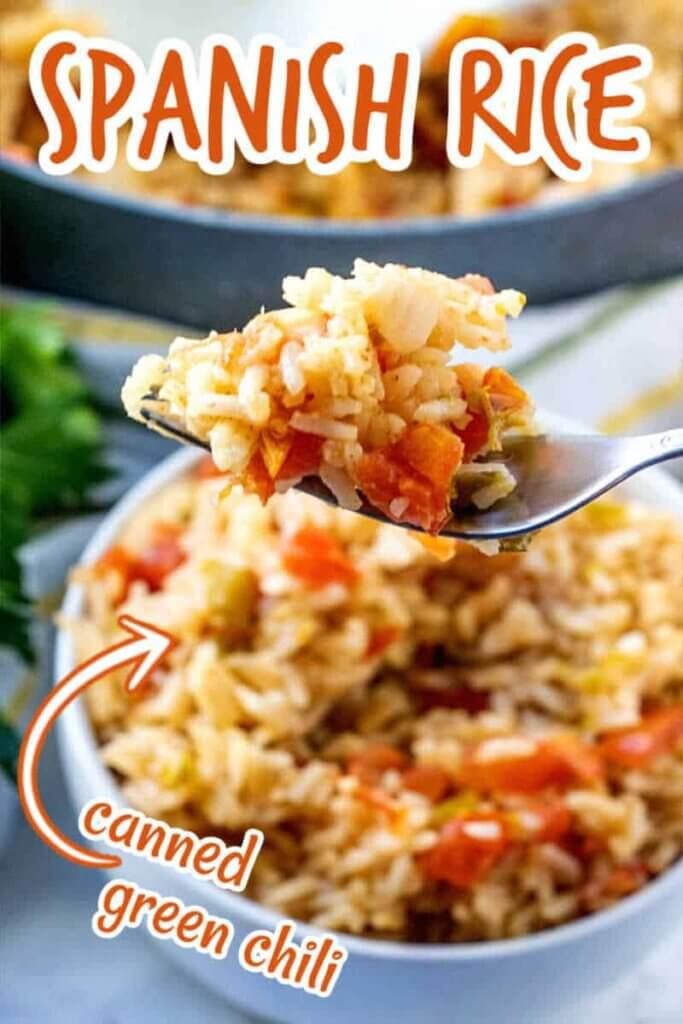 A bowlful of Spanish rice with a forkful being held close to the camera lens. Text above for pinning.