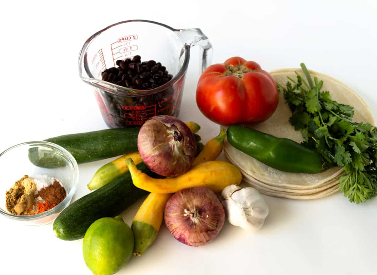 Photo of all of the ingredients for a quick meal before any vegetables are prepared.