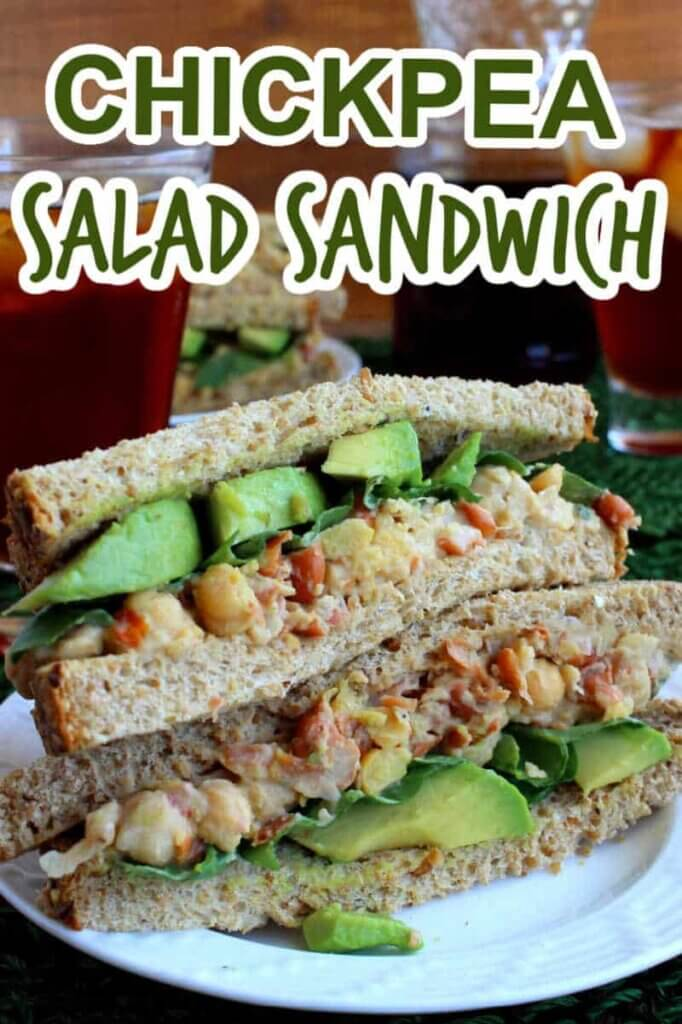 Two chickpea sandwich halves stacked on top of each other to show the veggies inside. Text above for pinning.