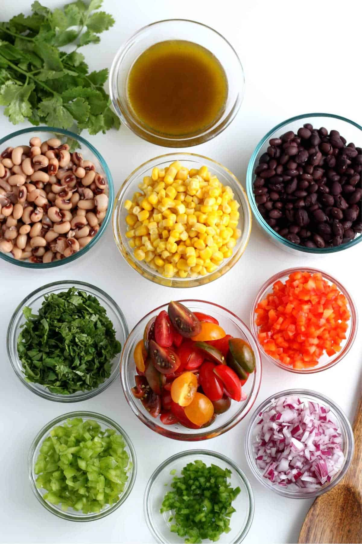 Overhead view of each ingredient pared and diced and in their own small bowl.