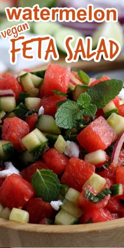 An extreme closeup of a watermelon salad in small cubes and mixed with cucumber and feta.