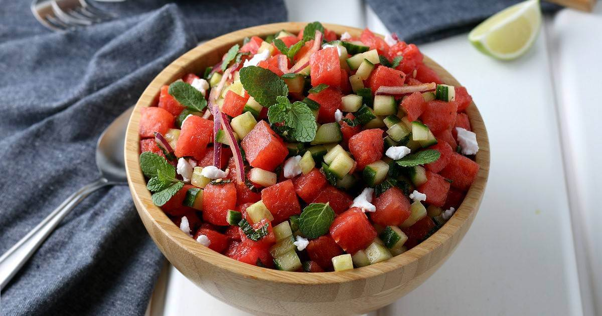 Bowlful of healthy and refreshing fruit. Served in a wood bowl and a wide photo.