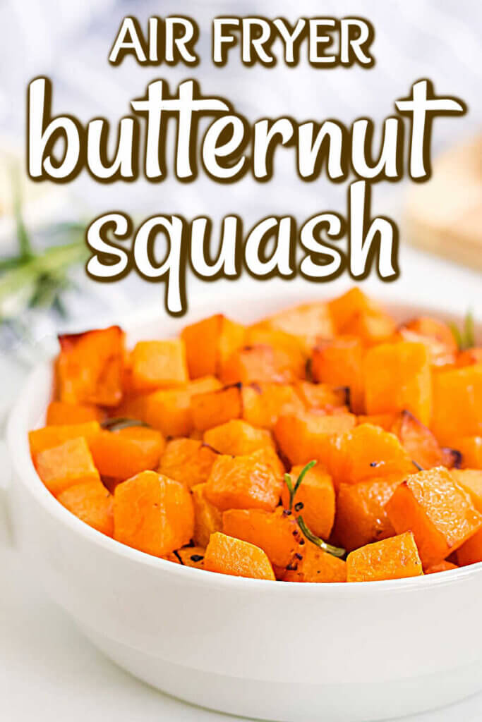 Close up look at a white bowl full of cooked and cubed butternut squash.