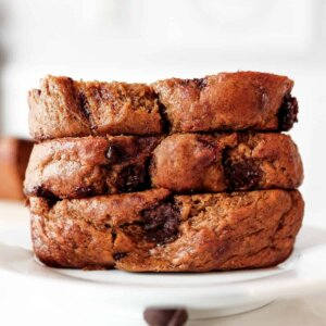 Front view of three stacked slices of chocolate chip banana bread filling the frame.