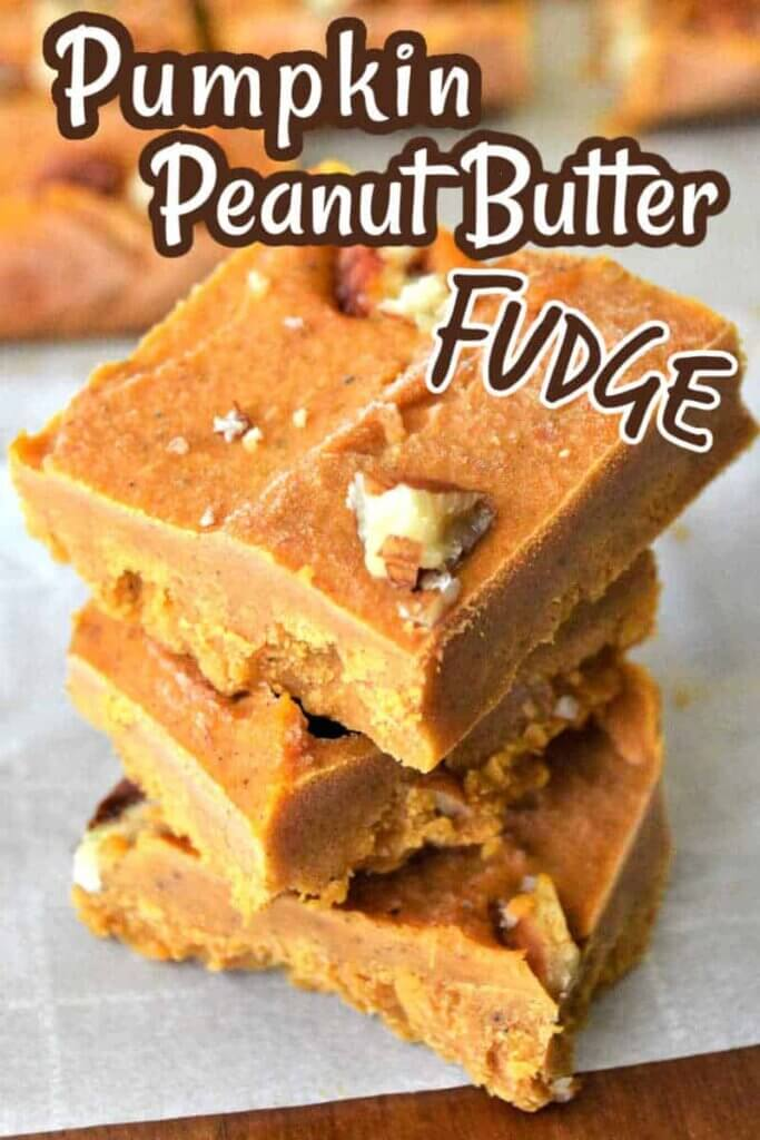 Three squares of pumpkin and pecan fudge stacked on top of each other.
