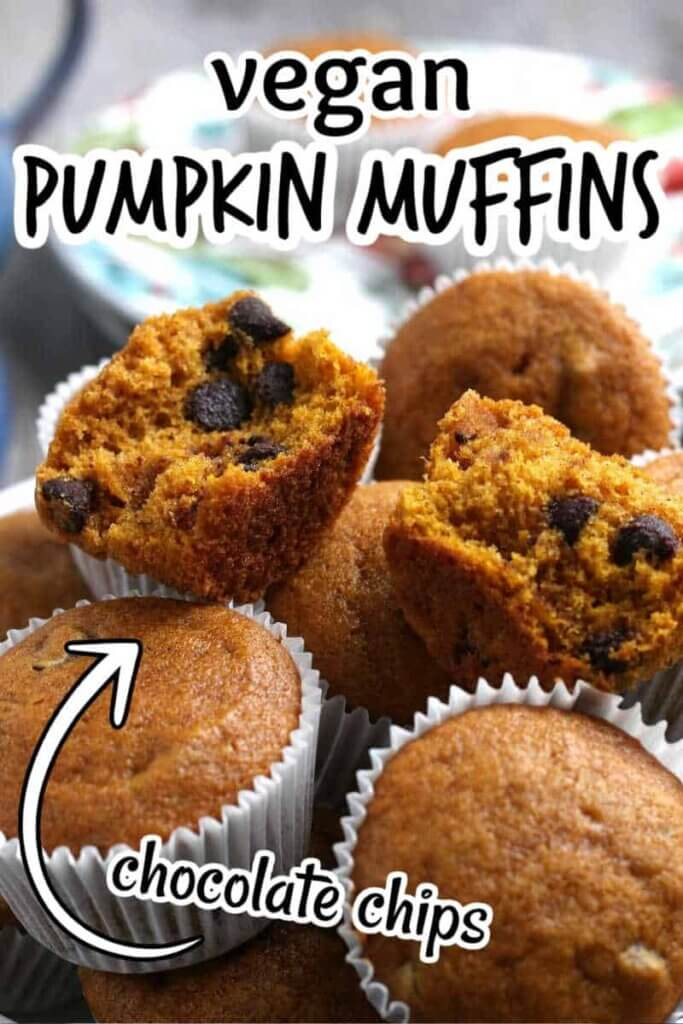 A dozen pumpkin muffins in white paper cups piled in a bowl.