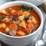 Close up of an instant pot vegetable soup with potatoes, carrots and mushrooms.