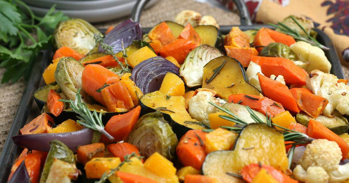 Wide photo of roasted veggies in autumn colors.