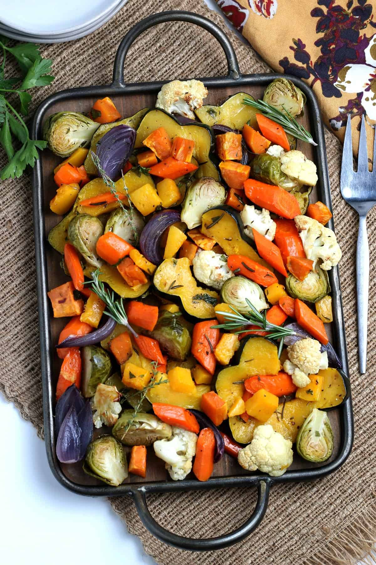 Overhead view of a large platter full of colorful autumn roasted vegetables.