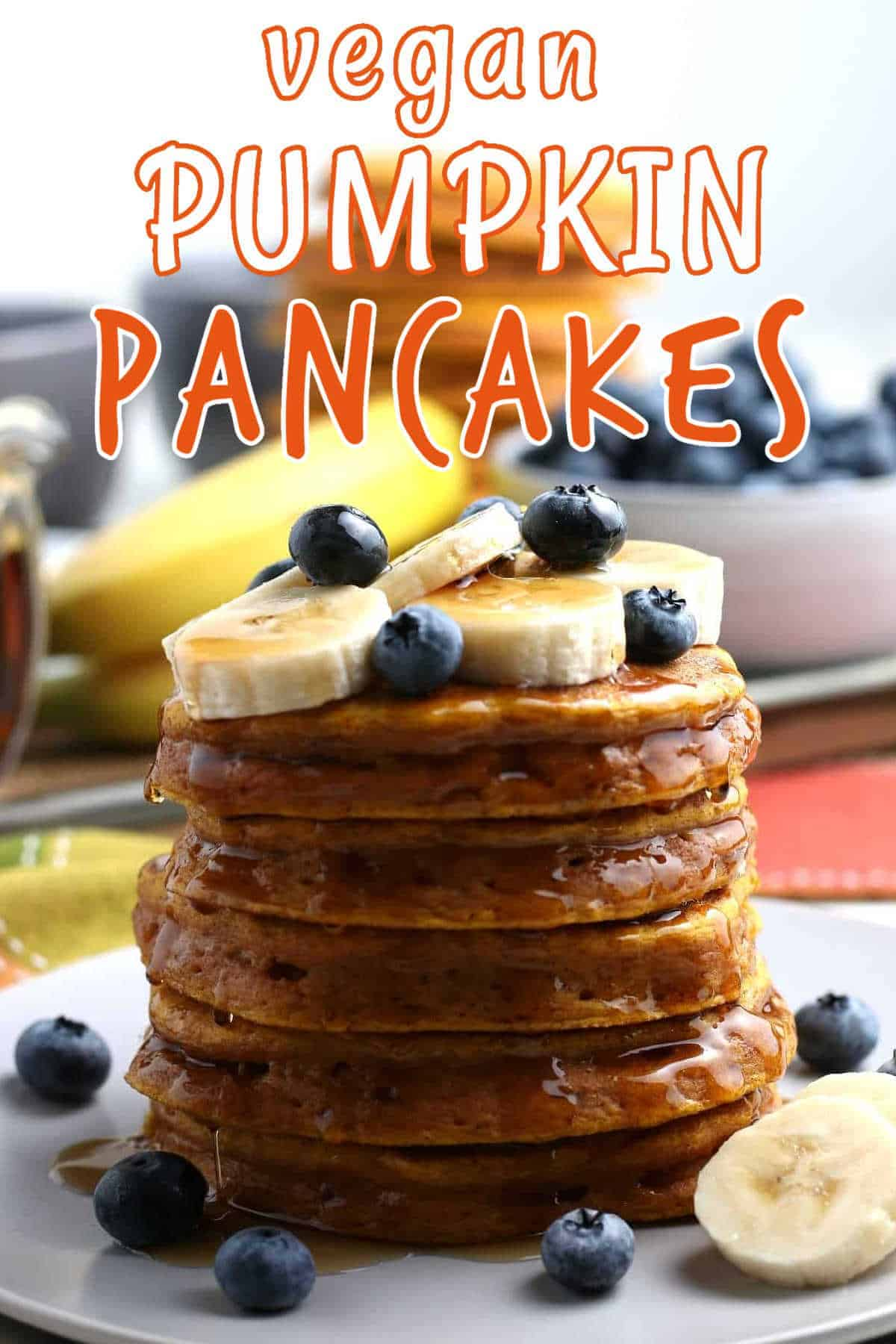 Five pancakes stacked high with syrup and fruit on top and orange text above that.