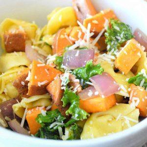 Close up photo of vegan cheese tortellini and sweet potatoes.