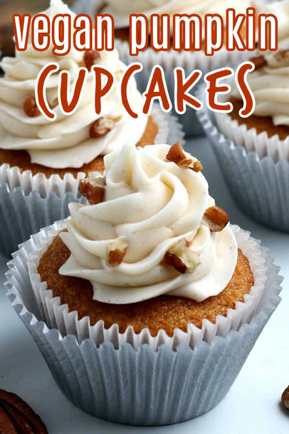 Close up of a vegan pumpkin cupcake with text above in white and orange.