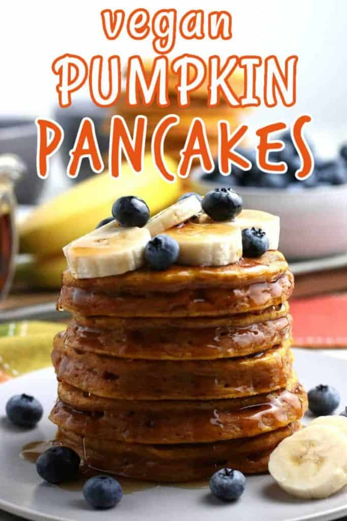 Five pancakes high with syrup and fruit and text at the top pf the photo.