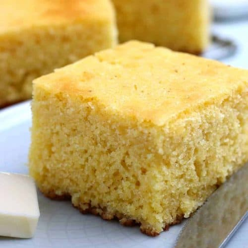 Close up view of a fat piece of cornbread.