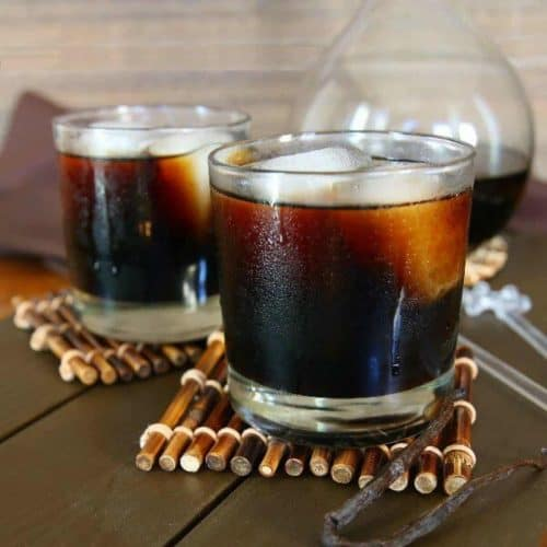 Two glasses filled with ice and dark Kahlua.