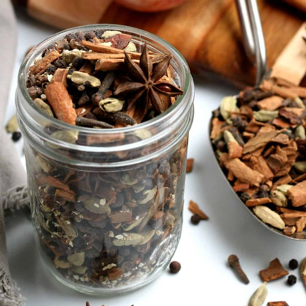 Canning jar filled with earthy flavors and a spice filled scoop.