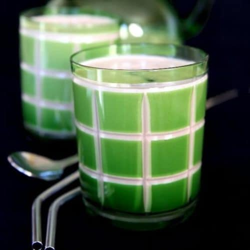 Green etched glass filled with a Vegan Baileys Irish Cream Whiskey.