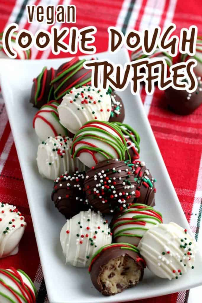 White rectangle plate piled with red, green and white chocolate cookie dough truffles.