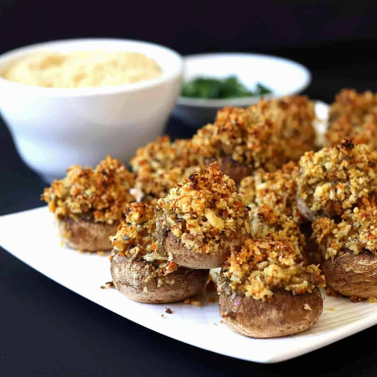 Stuffed Mushrooms plated with ingredients behind.