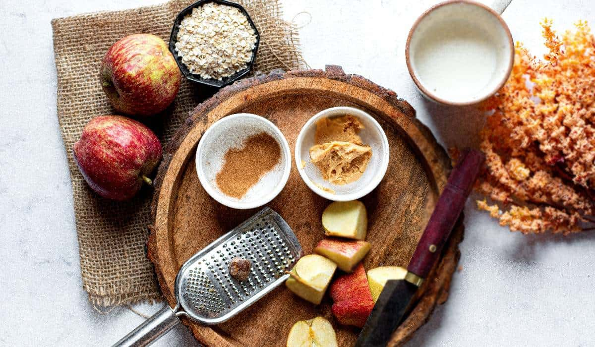 Six ingredients for a peanut butter apple smoothie.