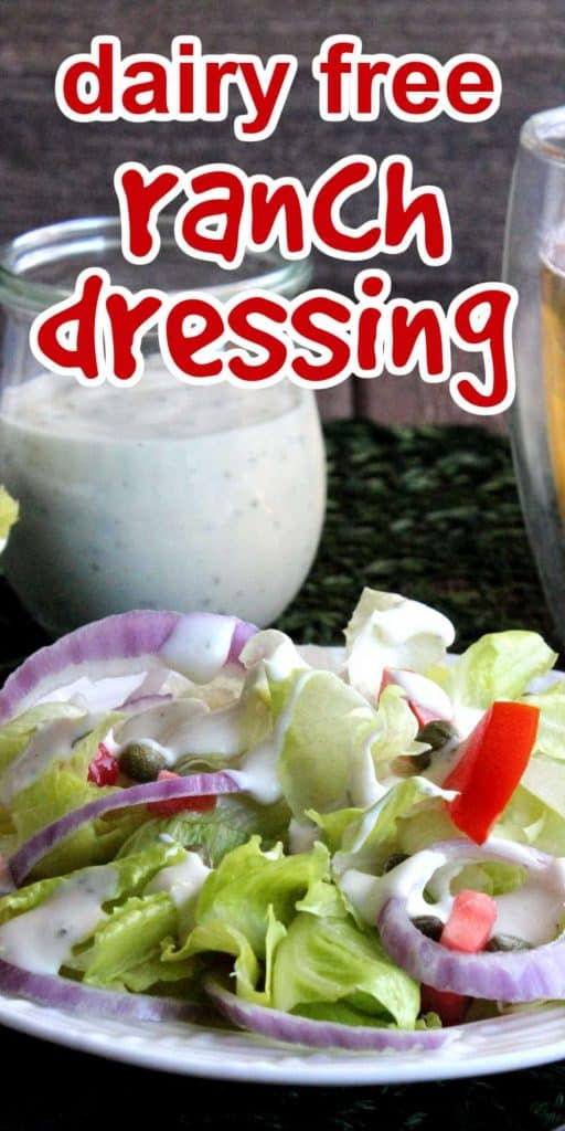 Jar of ranch dressing behinda a fresh green salad.