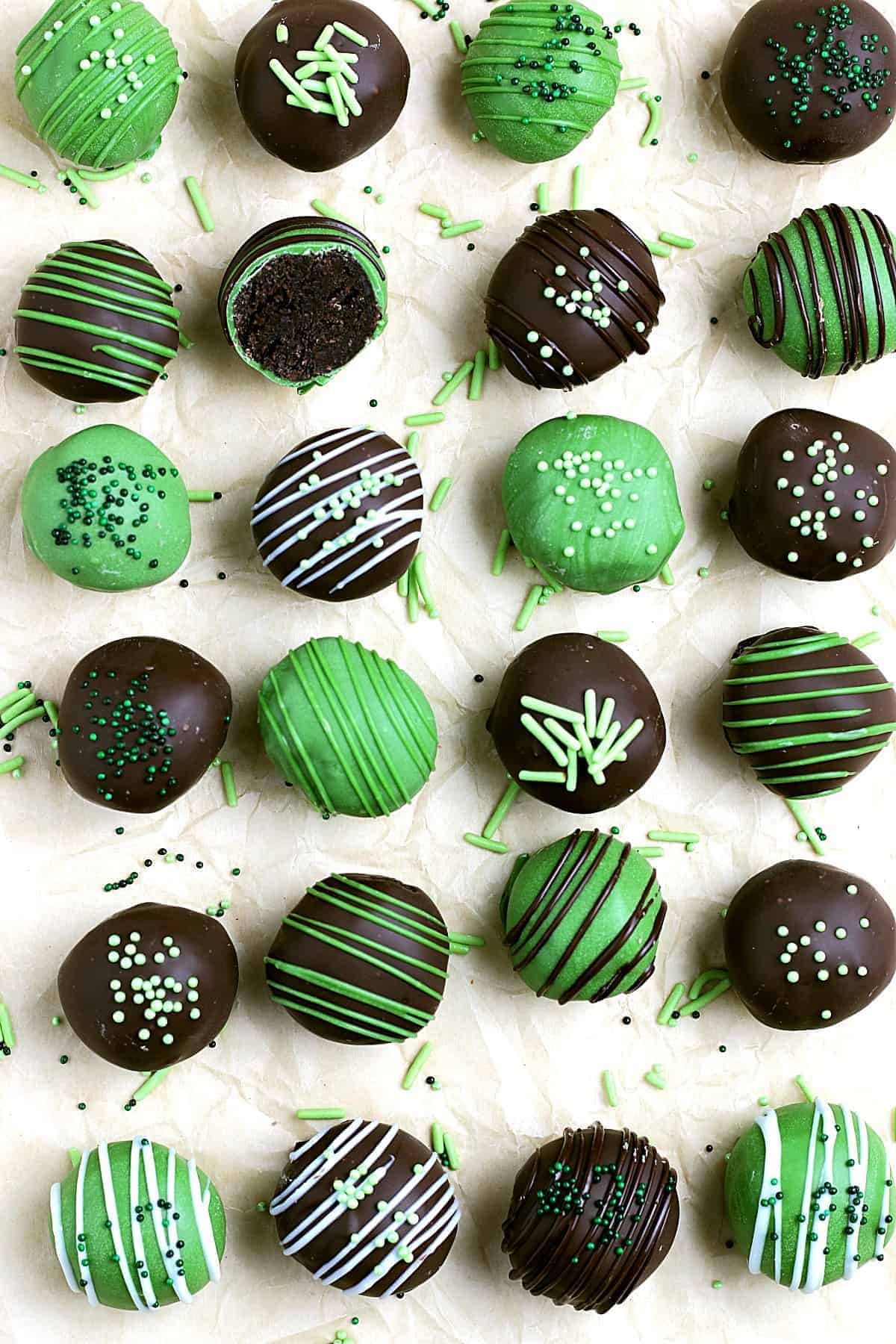 Overhead view of lined up mint cookie dough truffles candy.