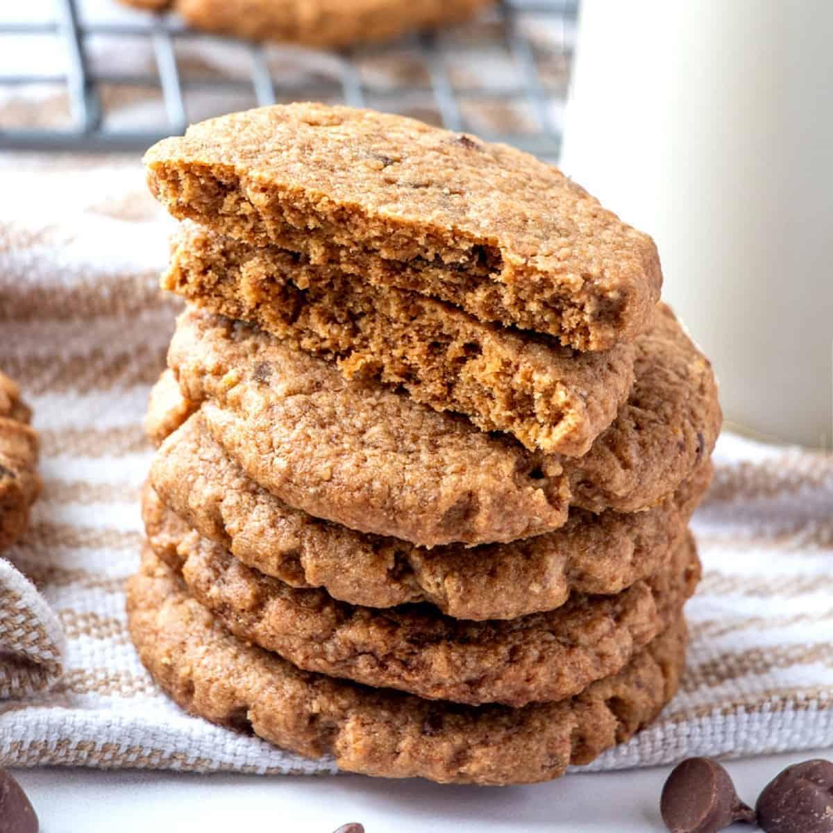 Stack of five peanut Butter vegan cookies with the top one broken open.