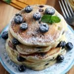 A stack of a vegan pancakes recipe cooked and sitting on a plate.