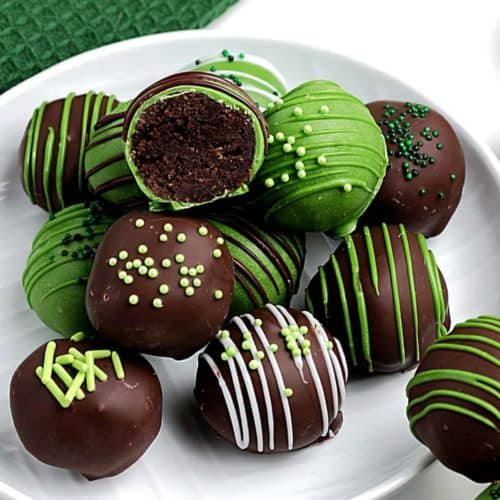 Chocolate and Green candy truffles are decorated with icing and sprinkles.
