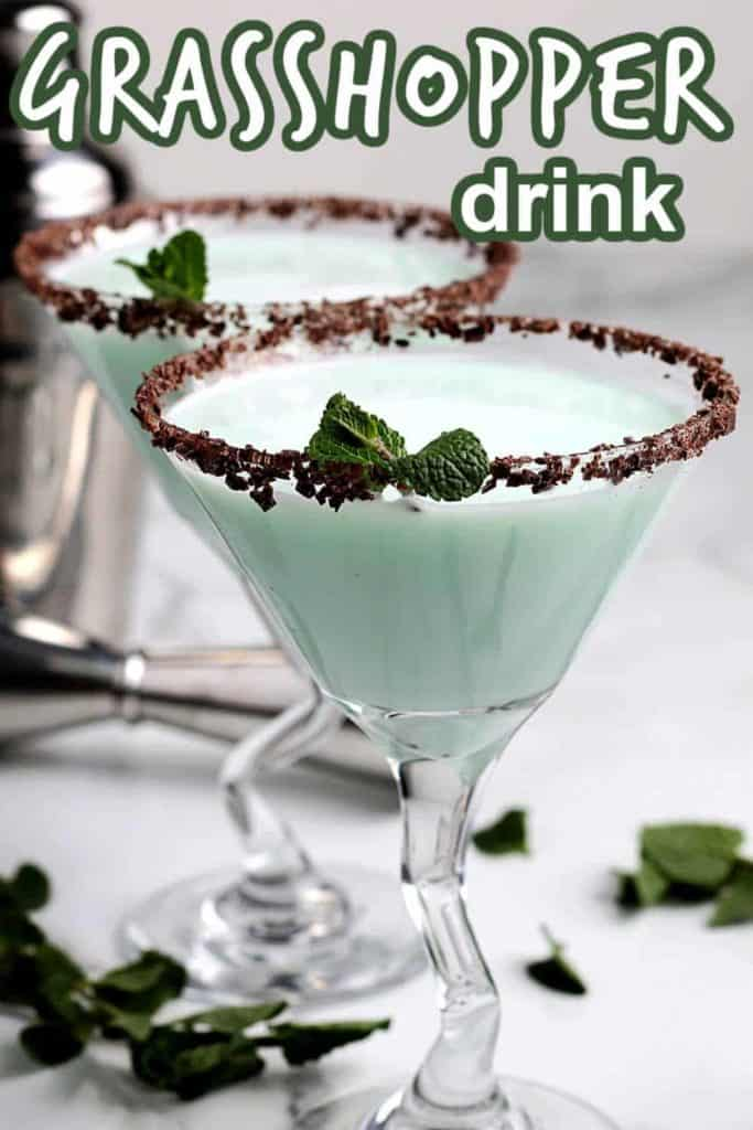 Two stemmed martini glasses filled with a frothy mint green cocktail.
