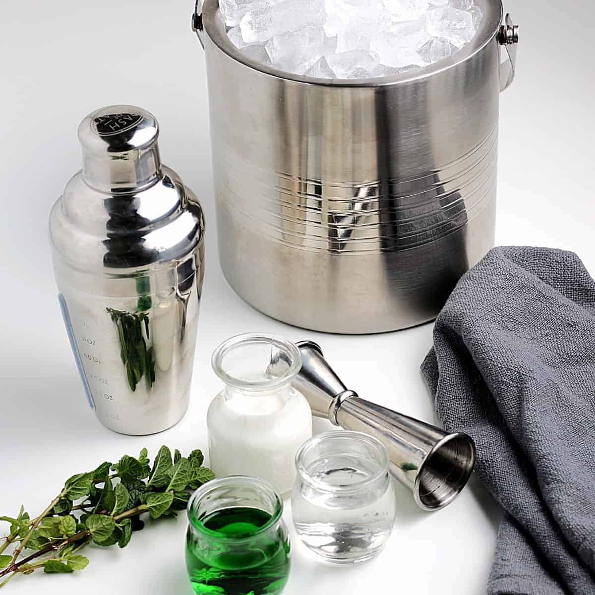 All of the ingredients to make a green Grasshopper Drink.