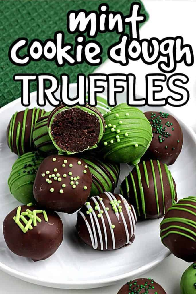 Chocolate and green decorated truffles on a white plate.